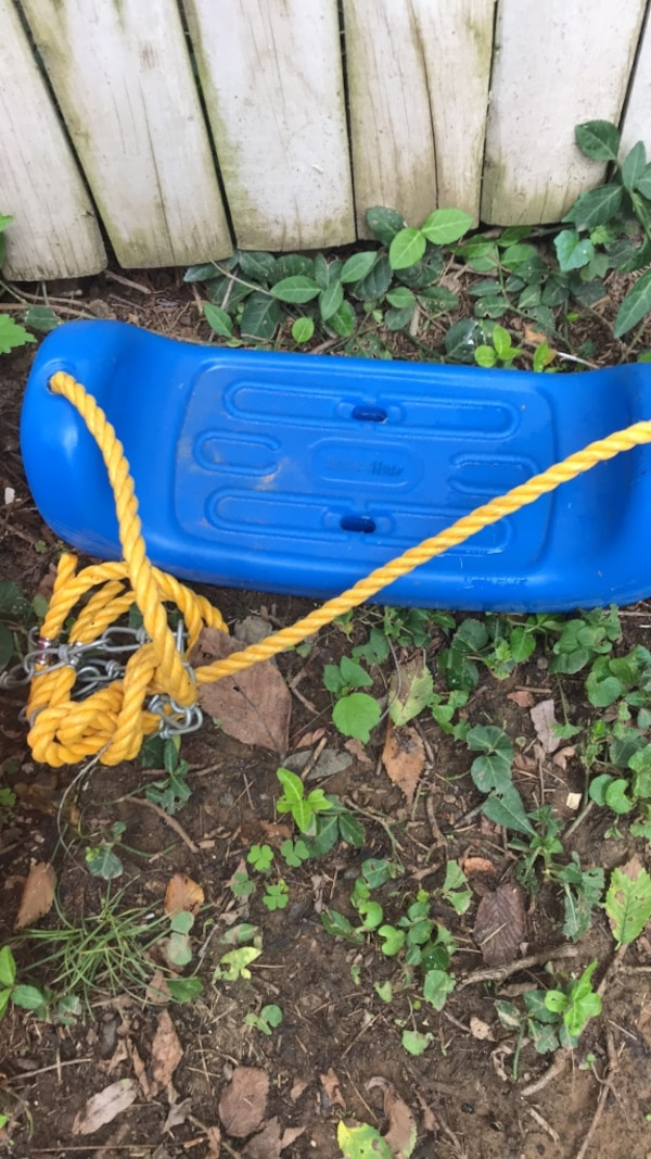 Blue plastic swing with rope
