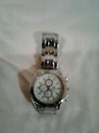 round silver-colored chronograph watch with link b Calgary, T2A 1R5