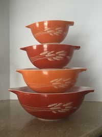 three red-and-brown ceramic bowls