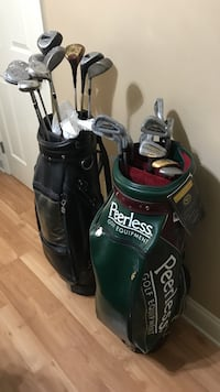 2 Golf bags and various model Golf clubs