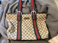 brown and black Gucci leather tote bag
