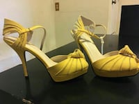pair of yellow leather open-toe heeled sandals El Paso, 79905