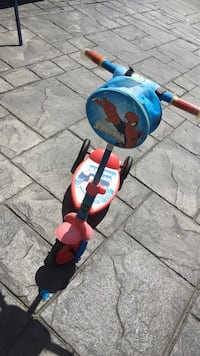 children's red and blue Spider-Man themed kick scooter