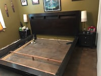 black and brown wooden bed frame 2260 mi