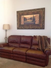 """Leather sofa recliners on ends nail head decor on arms $300.00(sold), large tuscany picture 5'x40"""" $125.00, woolridge leather trimmed blanket $15.00 obo"""