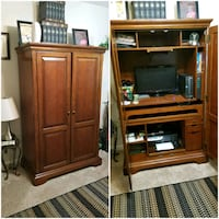 brown wooden TV hutch with flat screen television Columbia, 29229