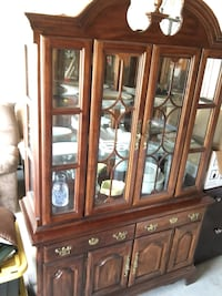 brown wooden framed glass china cabinet North Charleston, 29456