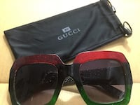 Red, black, and green framed gucci sunglasses with drawstring pouch Washington, 20002