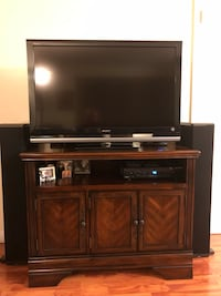 flat screen television with brown wooden TV stand Burbank, 91501