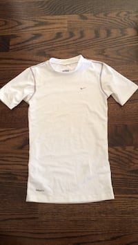Kids size L. Nike swim shirt