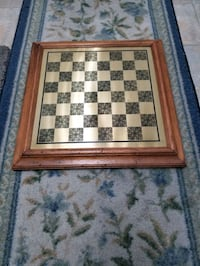 Wood framed brass coloured metal chess board