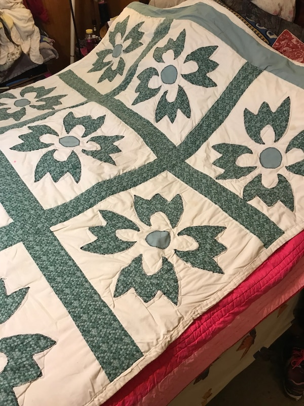 white, green, and brown floral area rug