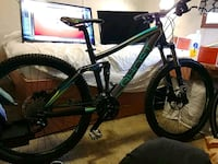 green and black hard tail mountain bike Surrey, V3T 1X1