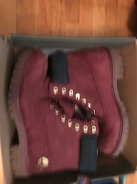 pair of red Timberland work boots Calgary, T2K 0C7
