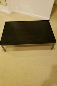 black wooden coffee table with black metal base