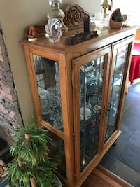 Brown wooden framed glass curio cabinet  Kent, 98031