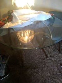 round clear glass top table with brown wooden base Waco, 76705