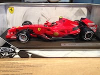 Red and black Hot Wheels Ferrari F20G7 scale model with box