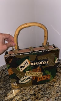 Cigar box decoration. Can be used as a purse with clasp for security