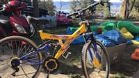 yellow and blue full-suspension mountain bike
