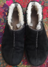 Pair of black ugg shoes