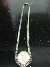 silver-colored chained necklace and round silver-colored coin