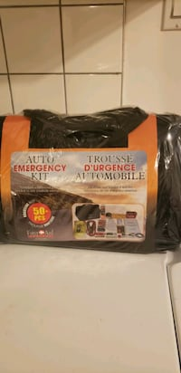 BRAND NEW NEVER OPENED 50 PLUS PIECES AUTO EMERGENCY AND FIRST AID KIT