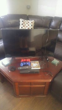 Ps3 with 2 controllers and element smart tv39 in Winnipeg, R2W 2N9