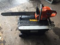 red and black Homelite chainsaw 580 mi
