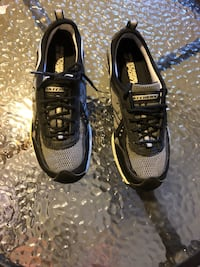 pair of black-and-white Nike running shoes Winnipeg, R2K 4A1