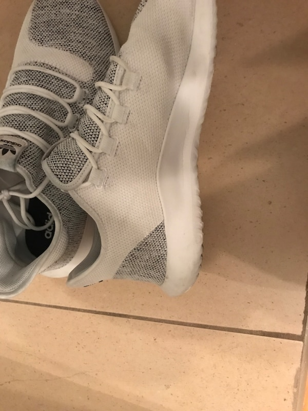 cdd21f0df224 Used Selling Adidas tubular shadow all white. only dirty spot is the one  you see on the picture but other then that clean. Size 12. for sale in  Montréal - ...