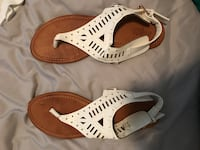 Pair of white-and-brown leather sandals Round Rock, 78664