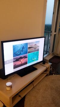 50 inch Samsung TV and its table from IKEA Toronto