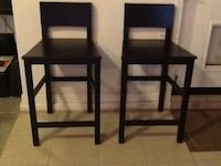 two black wooden bar stools