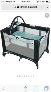 baby's black and white Graco pack n play travel cot screenshot