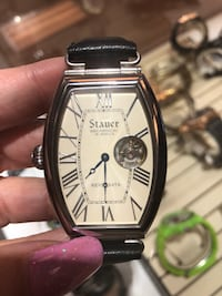 2 faced Stauer Swiss made watch. Going to church? Wear the white face. Going out? Wear the black face. The choice is yours. Tucson, 85712