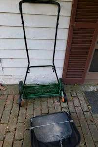 black and green reel mower