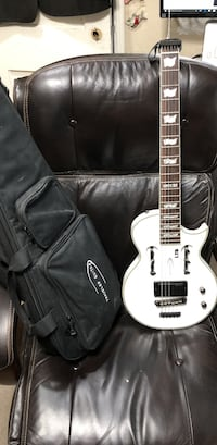 white and black electric guitar with case Miami, 33134