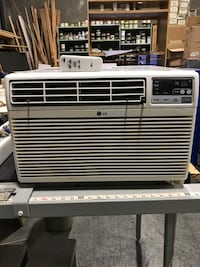 White LG window-type AC unit. Very few hrs used! Remote control.  Works awesome.