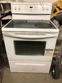 White and black induction range oven Toronto, M2N 3N6