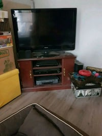 flat screen TV and brown wooden TV stand St. Catharines