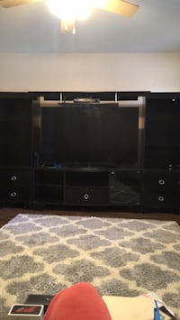 black wooden TV stand with flat screen television Lubbock, 79413