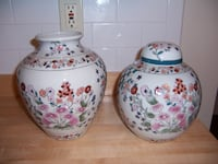 two white-and-pink floral ceramic jars 323 mi