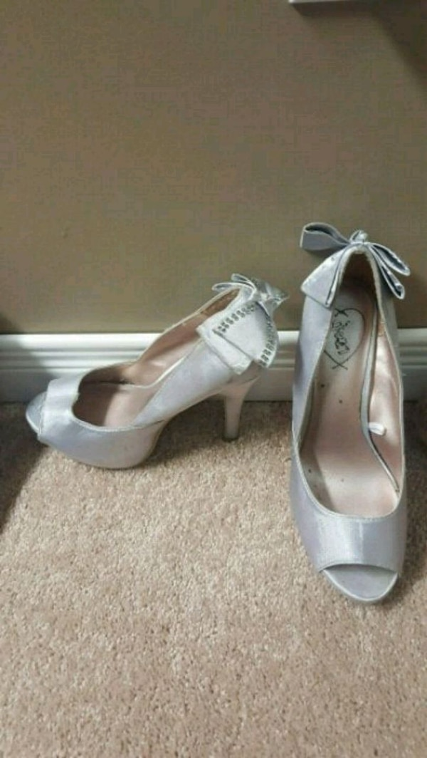 Silver heels with bow