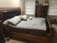 Sleigh King Bed. Leather headboard and beautiful Wood . Mattress not included. Marlboro, 07746