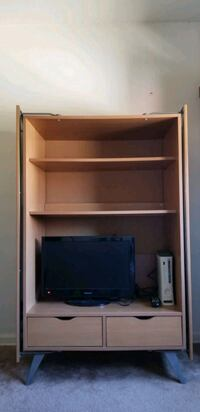 Cabinet with folding doors