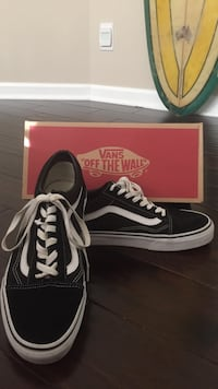 Pair of black-and-white vans off the wall low-top sneakers