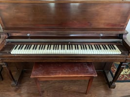 Antique piano and piano bench