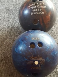 two black and blue Triple Crown and Columbia bowli