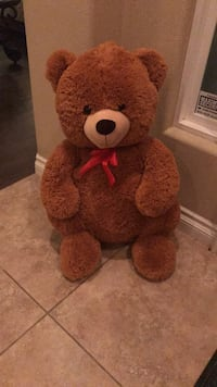 Brown and red bear plush toy La Quinta, 92253